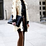 A furry topper and sleek clutch had just the right air of sophistication for Fashion Week in Paris.