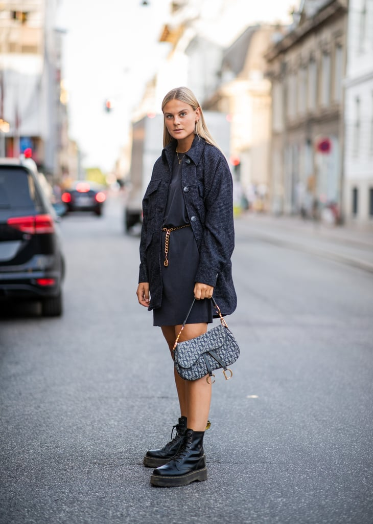 Wear a long denim jacket over your minidress and carry a logo bag.