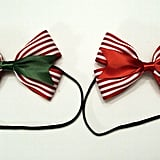 We'd like to give these candy cane hair bow headbands ($8) as a fun Secret Santa gift this holiday season. You can also ask the seller to give you the barrette version, too.