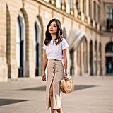 For brunch, tuck a white tee into a midi skirt and finish with a wooden bag and sandals for a Summery feel.