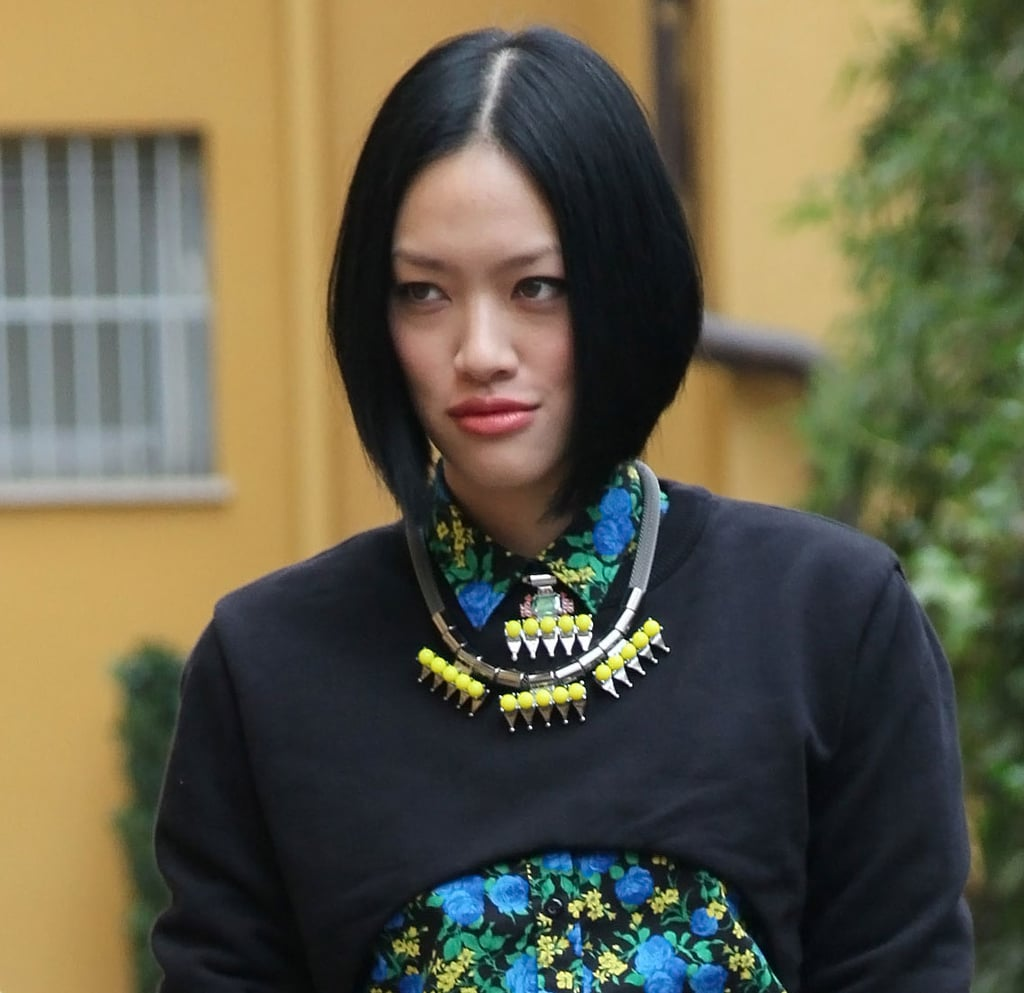 A modern statement piece picked up the colors in her brilliant top. Source: Greg Kessler