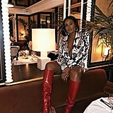 An Animal-Print Dress and Red Knee-High Boots