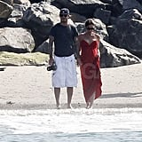 Victoria Beckham pregnant with David on the beach.