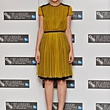 Carey glowed in a mustard Proenza Schouler dress with black trim detail and matching YSL platforms at a 2010 London photocall for Never Let Me Go.