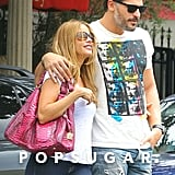 Joe held Sofia close when they left the cafe on Saturday.