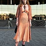 Styling an orange sheer dress with black underwear.