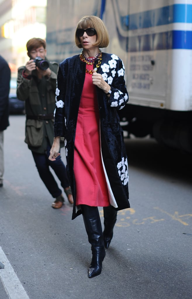Anna Wintour made her way into the Calvin Klein Collection show in a floral Prada coat, a pink dress, black leather knee-high boots, and a few sparkly necklaces.