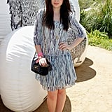 Lily Collins took a pretty approach to party style in a printed dress and Mulberry bow-adorned flats at Mulberry's poolside BBQ.