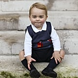 The royal, who was just shy of 17 months old, sat on the steps in a courtyard at Kensington Palace for the festive photos.