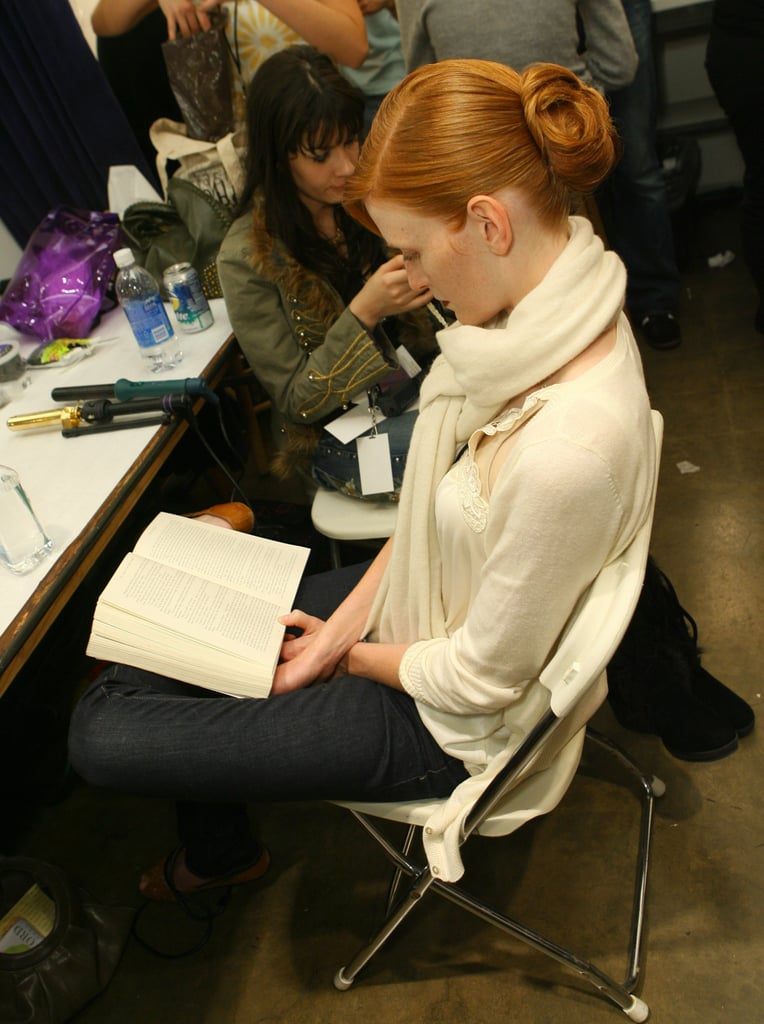 A model focused on her book backstage during LA Fashion Week in 2007.