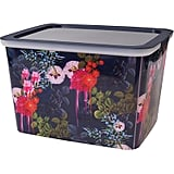 """The New Year is a time to clean out and tidy up, and there's no prettier way to store your belongings than in this dark floral 10"""" storage box ($13), part of fashion designer Cynthia Rowley's inspired office collection for Quill.  — MW"""