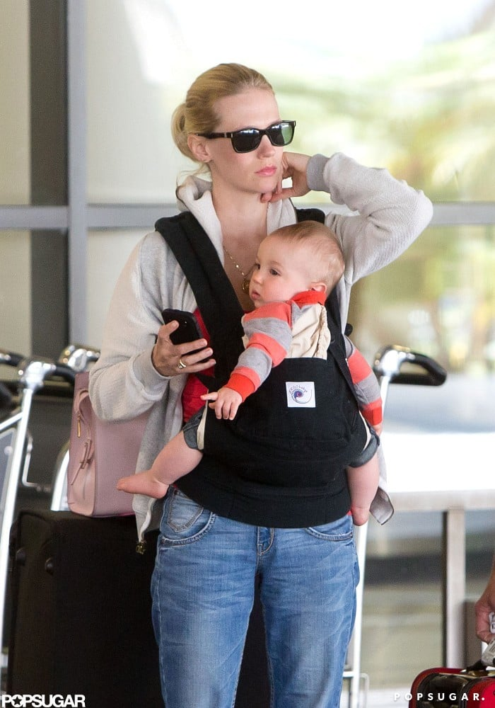 January Jones arrived at LAX yesterday accompanied by her son, Xander, who she sweetly kissed on the head while they waited for their ride. January went casual in jeans and a zip-up sweatshirt, while Xander donned a little striped sweater. The pair have been spending quality time together on both the East and West Coasts lately. While in NYC last month, January and Xander hit Whole Foods, but she was solo for a chic night out when she wore bright yellow Versace to the Met Gala. She also dressed up for the launch of The Shops at Target. January's front and center in the current season of her AMC hit. Make sure to check out our recap of the latest Mad Men episode.