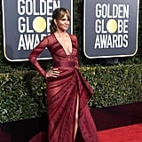 Halle Berry wearing a Zuhair Murad gown with multiple sheer panels and Loriblu shoes.