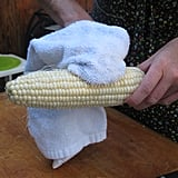 To remove any lingering silks, rub the cob with a dry clean kitchen towel.
