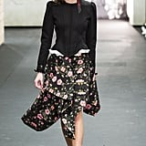 We can imagine Kate throwing this peplum blazer top over a cascading skirt for a daytime engagement.
