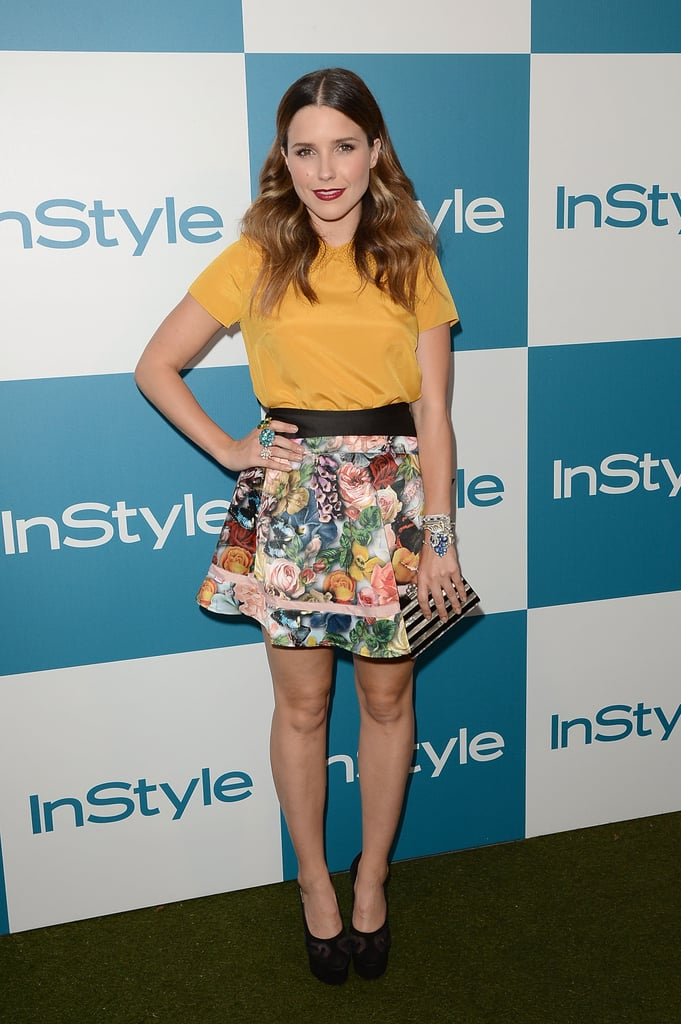 Sophia Bush kept it flirty and very floral in a Ted Baker London circle skirt and a collared mustard yellow top. Her striped Edie Parker clutch and black round-toe pumps completed the look.