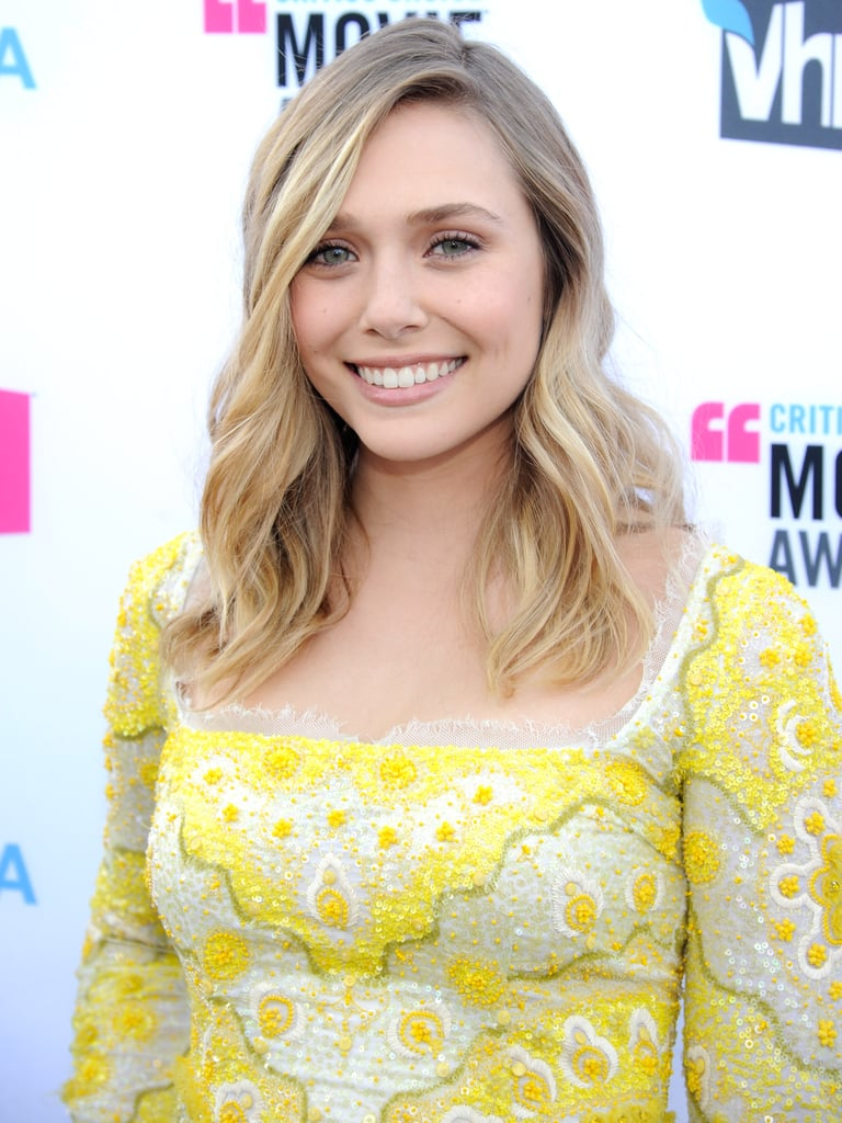 Elizabeth Olsen smiled in her yellow Emilio Pucci dress.