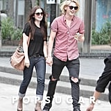 Jamie Campbell Bower and Lily Collins held hands in Toronto in July.