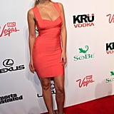Genevieve Morton wore a bright shade of coral for the soiree.