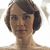 Mary has a simple bridal makeup look with a bit of '20s flair. Source: PBS