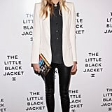 Jessica Hart outfitted a chic play on classic separates, topping a pair of skinny leather leggings with a white blazer. We love her quirky-cool add-ons: a cheeky novel clutch and gilded platforms.