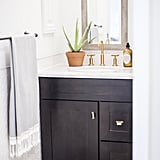 In addition to choosing a sink vanity with real drawers, we snuck in more storage by adding slim wall cabinets in two different places. We decided to paint them the same color as the walls and skip hardware so that you hardly notice them.    If you're looking for a streamlined process to renovate that doesn't require hiring an expensive interior designer or searching for a contractor on your own, you should definitely consider going the Decorist/Lowe's route. Access to an interior designer for these Decorist/Lowe's renovations will only set you back a flat fee of $299 — a rate that's otherwise hard to find. Renovations are never without hiccups, but having professional design advice and a project manager will help you troubleshoot storage or layout issues, avoid pricey mistakes, and remain organized. If you're thinking of a similar style for your own bathroom, check out my bathroom shopping list to get the look!