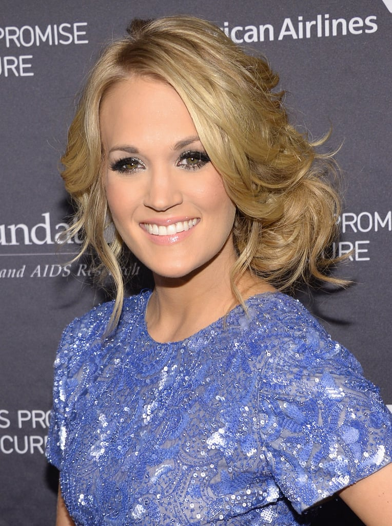 Carrie Underwood wore her hair in a messy sideswept chignon to pick up the Artist Achievement Award at the T.J. Martell Foundation's 38th annual Honors Gala in New York.