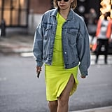 An oversize denim jacket quickly tones down an electric-yellow outfit.