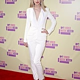 Taylor Swift went sexy in a J. Mendel pant suit and Tom Ford heels.