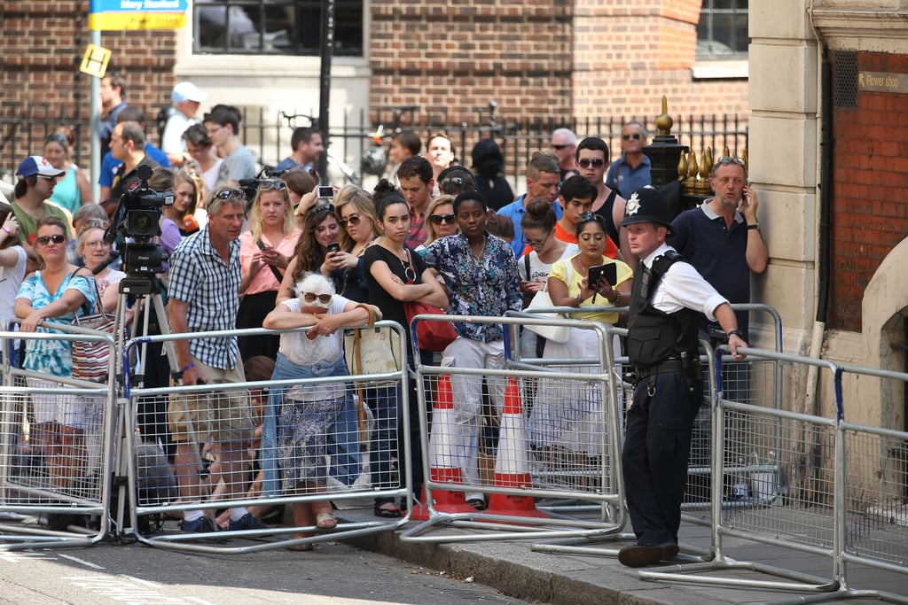 A police officer controlled the crowds of royal fans who are waiting outside the hospital.