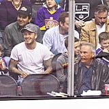 Victoria Beckham held son Cruz Beckham with David Beckham, Romeo Beckham, and Brooklyn Beckham all sitting together at the hockey game in LA.