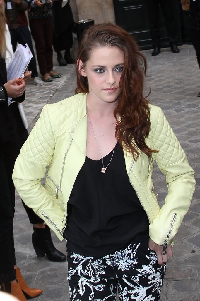Kristen Stewart posed in a lime green leather jacket and printed pants.