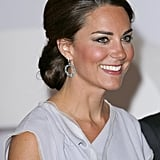 The Duchess went with an intricate updo.