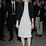 Jessica Chastain donned a sweet polka-dotted sheath, topped by a slick black blazer, at the Saint Laurent show.
