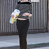 Anne Hathaway wore flats and black skinny jeans.
