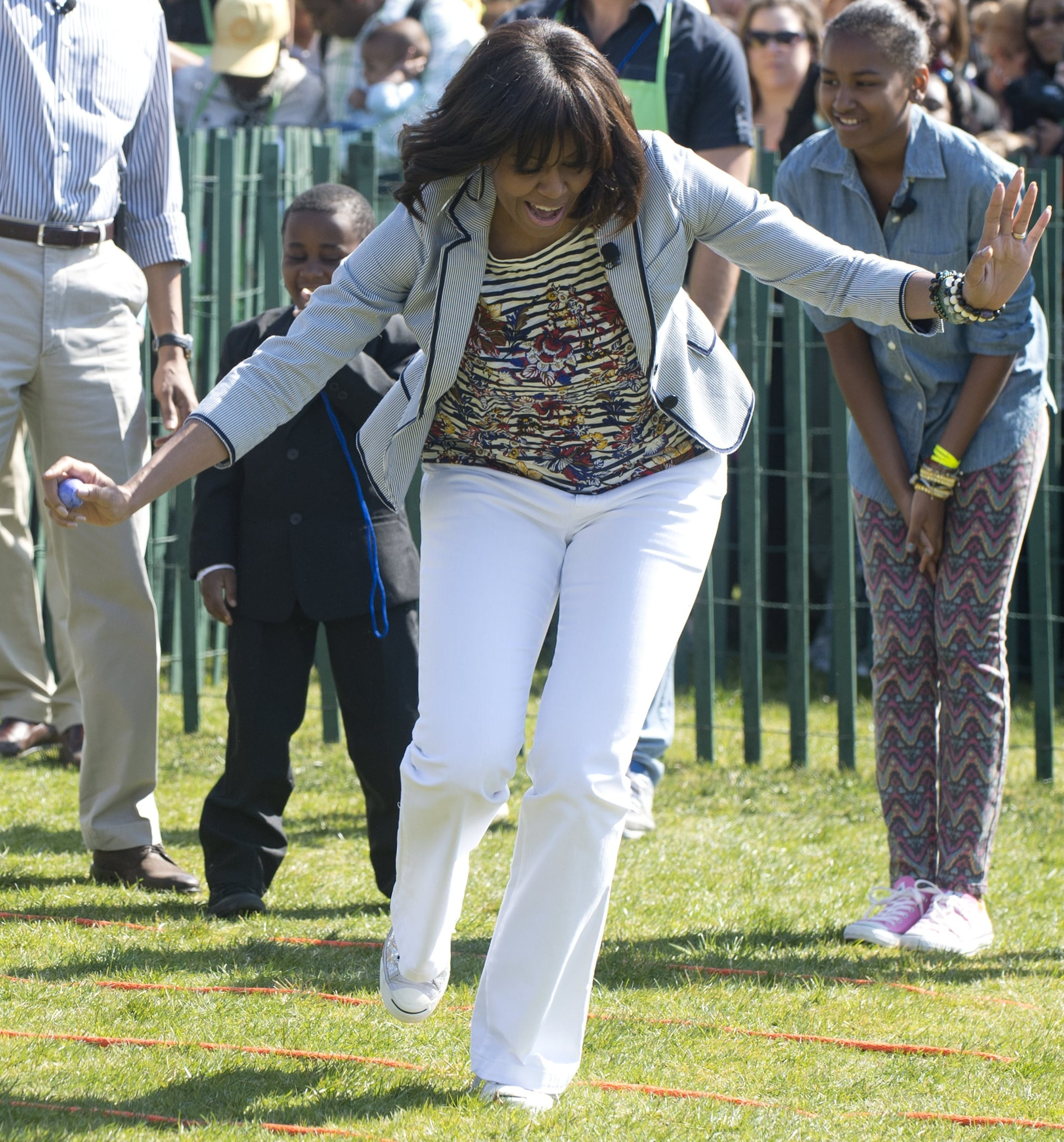 For the 2013 White House Easter Egg Roll, Michelle Obama looked fresh in pieces she's actually already worn before. She styled white pants with a striped and floral J.Crew t-shirt and a seersucker Talbots blazer.