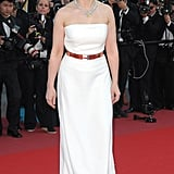 Juliette Binoche wore a custom-made off-white bustier Celine gown at the Palme d'Or Award Ceremony. Her pink gold metal belt added sass to her look.