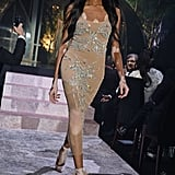 A little glitz, a little glamour, she's got it all covered while strolling down the catwalk in France.