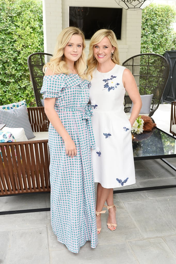 Reese Witherspoon brought her 17-year-old daughter, Ava Phillippe, along for the LA launch of her Draper James collaboration with Net-a-Porter on Tuesday. The mother-daughter duo (who, let's be honest, can totally pass for sisters) posed for photos in sweet summery dresses at the chic Beverly Hills soiree, which brought out some of Reese's celebrity friends, including Jennifer Garner, Chelsea Handler, Rachel Zoe, and Camila Alves. We love getting to see Reese and Ava together; the last time they hit the red carpet was back in February at the premiere of Reese's hit HBO series Big Little Lies, but the actress also treated us to a few cute snaps of her look-alike daughter on Mother's Day in May and a family beach day in April.