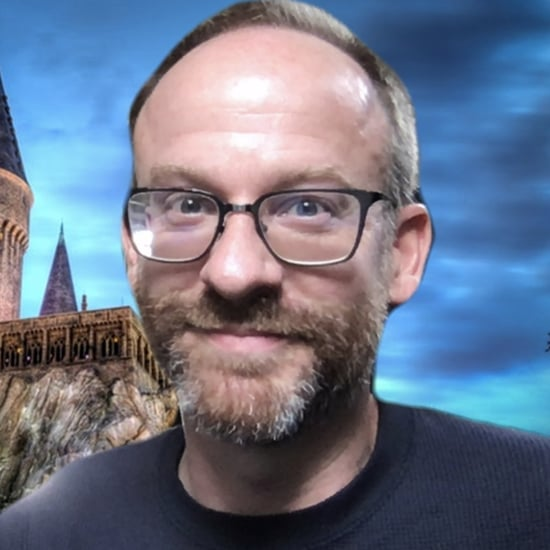Professor Teaching in Front of Virtual Hogwarts Backdrop