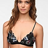 You need a pretty lace bra to wear under Fall's slinky dresses, and Urban Outfitters' Lace Triangle Bralette ($16) is a steal.