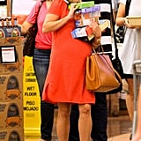 Reese Witherspoon stacked five boxes all the while chatting on her cell phone.