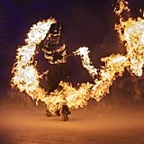 A fire performer does some risky stunts.