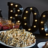 Even if your sweets aren't obviously themed, a lit marquee can add festive flair to the dessert buffet.