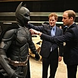 Harry and William couldn't help but get up close and personal with a Batsuit at Warner Bros. Studios in London back in April 2013.