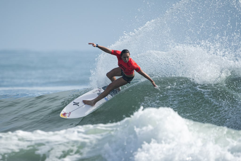 Women's surfing is used to fierce world title races, but the one we're seeing in 2019 is truly unprecedented. With one contest left in this roller coaster of a season, three women have a chance to win the world title. All three have a shot at making the 2020 Olympics, where surfing will be making its debut. And all three are American — which, for the Olympics, makes things complicated. Currently, Carissa Moore sits in first, with Lakey Peterson in second and 17-year-old Caroline Marks, in just her second year on the tour, following in third. Scenarios have been mapped out and analyzed. Each of the surfers has a chance at both the world title and the Olympics depending on the results of one last competition, the Lululemon Maui Pro. But here's the wrinkle: the US only has two Olympic spots to hand out.  Here's how it works. Throughout the season, surfers are awarded points based on their performance in 10 Championship Tour contests. The world title goes to the surfer with the most points at the end of the year. This year, placement in the Championship Tour also counts for Olympic qualification: the top eight women will secure a place in Tokyo should their country have an open spot. Basically, no matter how it shakes out, the US will bring the top two women's surfers in the world to the 2020 Olympics. It's great news for Team USA, but for the athletes battling for those spots, it makes this final competition one of the biggest of their lives. POPSUGAR sat down with Carissa, Lakey, and Caroline to see how they're handling the pressure, excitement, and fierce competition before they hit the waves one last time in 2019. (To watch the contest yourself, check out the World Surf League's live stream; the surfers will be paddling out in the next two weeks, depending on the wave forecast.)      Related:                                                                                                           Mikaela Shiffrin Breaks the Record For Most World Cup Slalom Wins — an