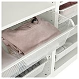 Use Pull-Out Baskets to Organize Folded Laundry