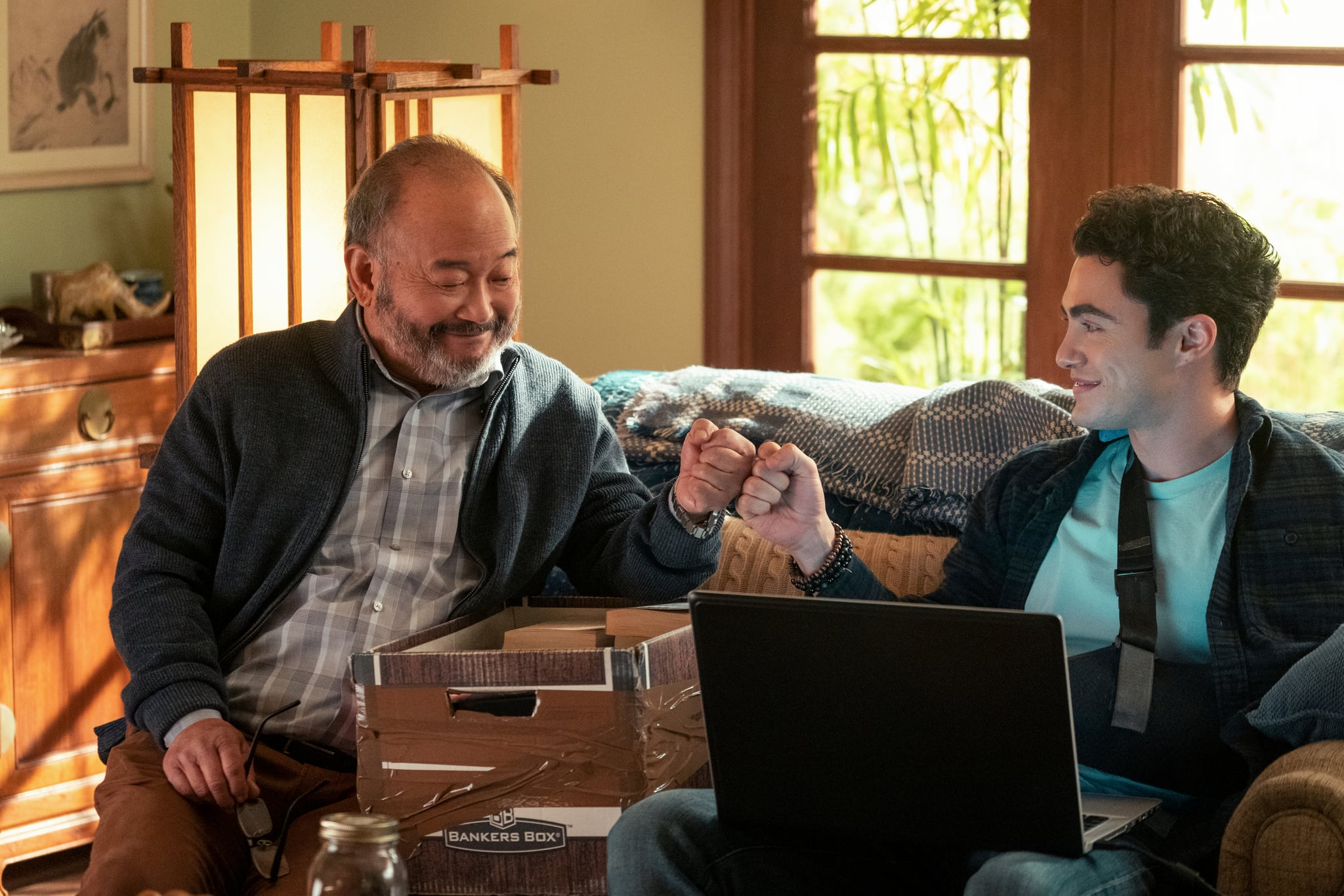 NEVER HAVE I EVER (L to R) CLYDE KUSATSU as TED and DARREN BARNET as PAXTON-HALL YOSHIDA in episode 203 of NEVER HAVE I EVER Cr. ISABELLA B. VOSMIKOVA/NETFLIX  2021