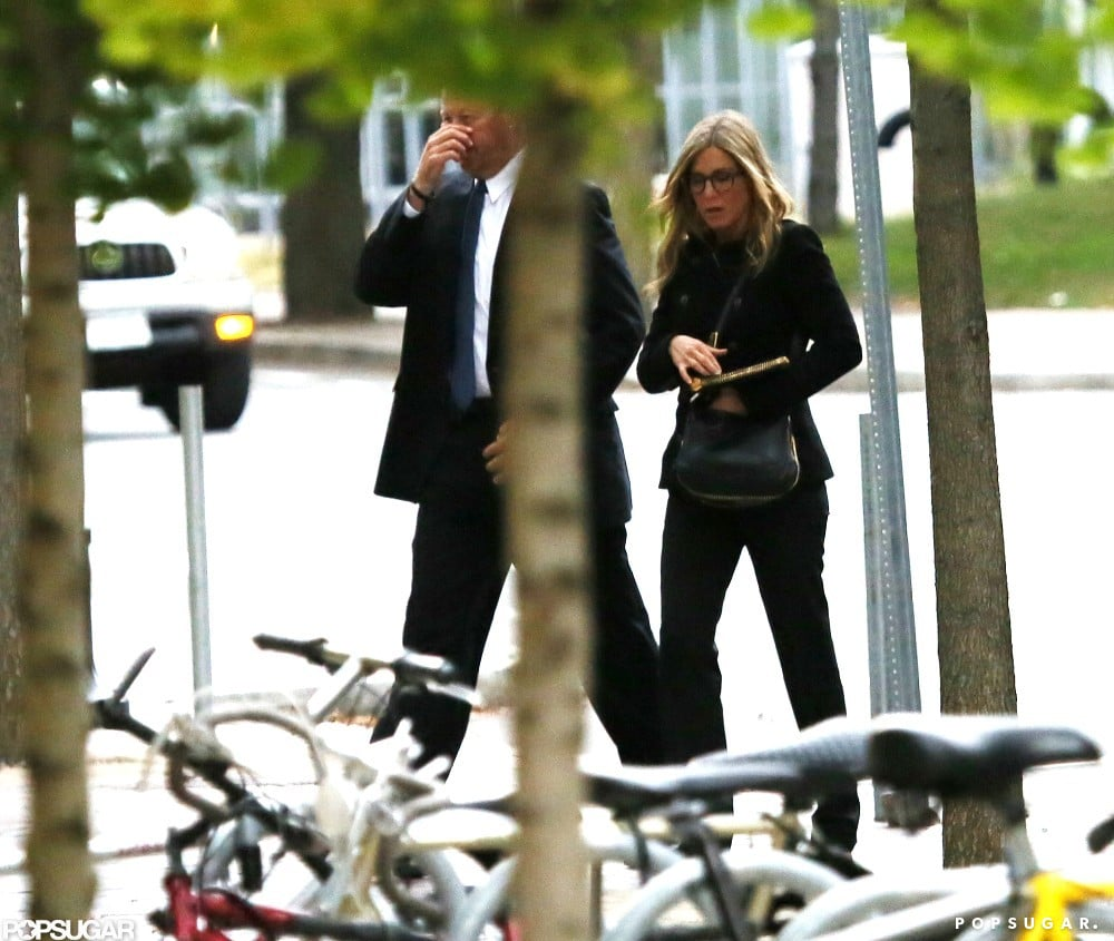 Jennifer Aniston showed off her figure in black pants and a jacket.