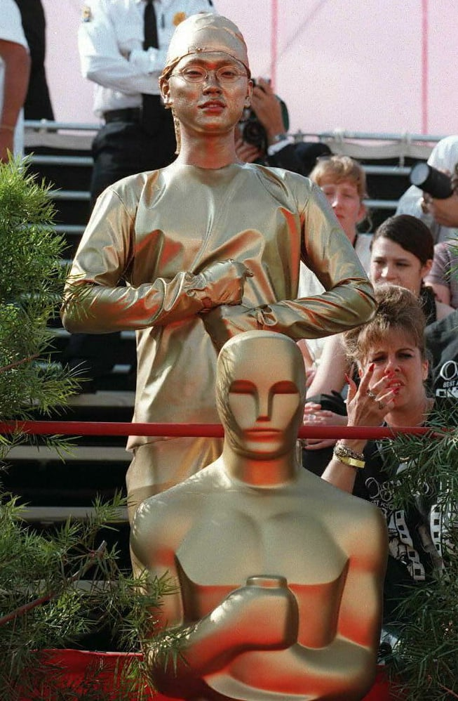 A Teenager Dressed Up as the Oscar Statue